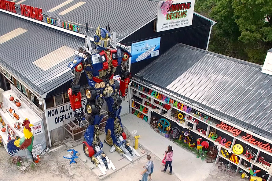 Exterior shot of Primitive Designs and massive robot