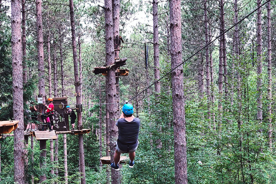 Person zip-lining in Ganaraska Forest in Port Hope
